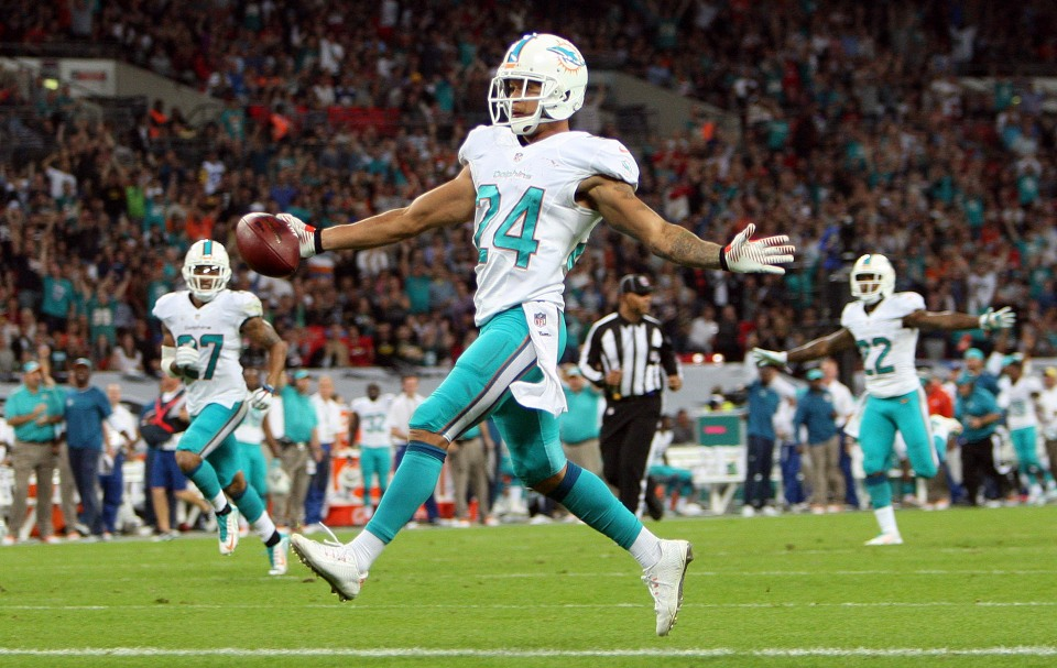 Miami Dolphins at Oakland Raiders NFL 28/09/14 Wembley Stadium,London. Cortland Finnegan celebrates scoring a touch down. Pic Nicky Hayes/NFL UK