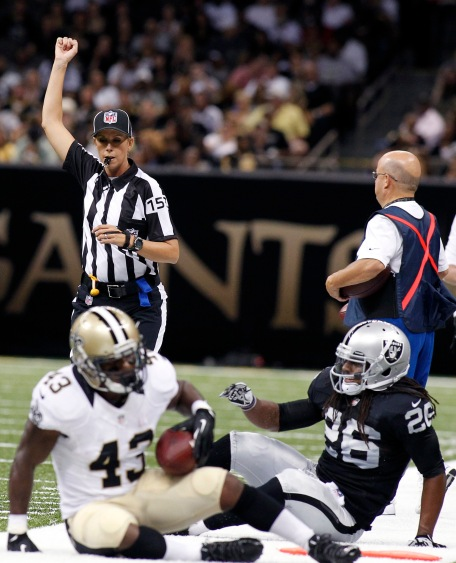 NFL referee Sarah Thomas, top left, works in the first half of an NFL preseason football game between the New Orleans Saints and the Oakland Raiders at the Mercedes-Benz Superdome in New Orleans, Friday, Aug. 16, 2013. (AP Photo/Jonathan Bachman)