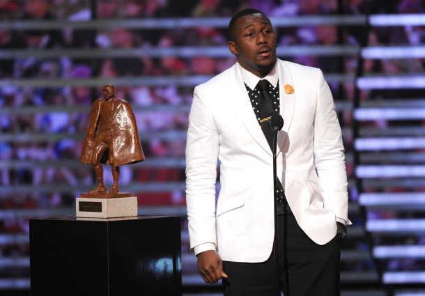 Thomas Davis, of the Carolina Panthers, accepts the Walter Payton  NFL man of the year award, presented by Nationwide, on stage at the 4th annual NFL Honors at the Phoenix Convention Center Symphony Hall on Saturday, Jan. 1, 2015. (Photo by Frank Micelotta/Invision for NFL/AP Images)