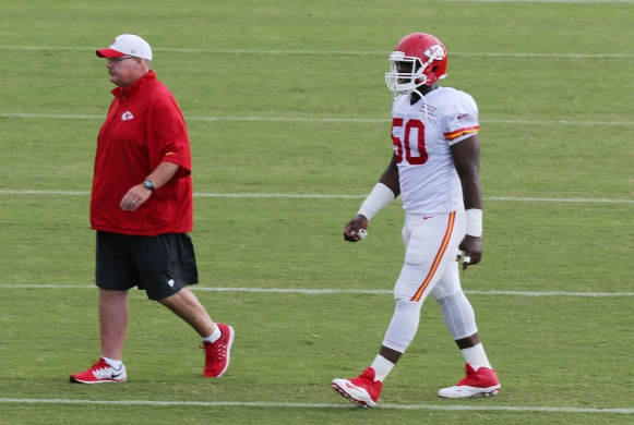 3/8/2015    NFL   Kansas City Training Camp  Players leave the practice field due to adverse weather- Head coach Andy Reid and Linebacker Justin Houston  Picture Dave Shopland/NFL UK