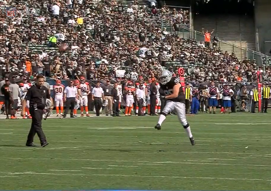 James Corden attempts a field goal at Raiders Game.